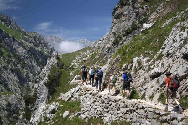 aszturia-img08-spain-picos-de-europa-walking-together-uphill-into-cares-gorgeE5E2AEA3-749A-463E-6BF4-35AB18B91B3F.jpg